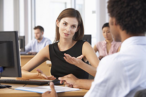 3-ways2resizedwoman and man chatting in a classroom setting