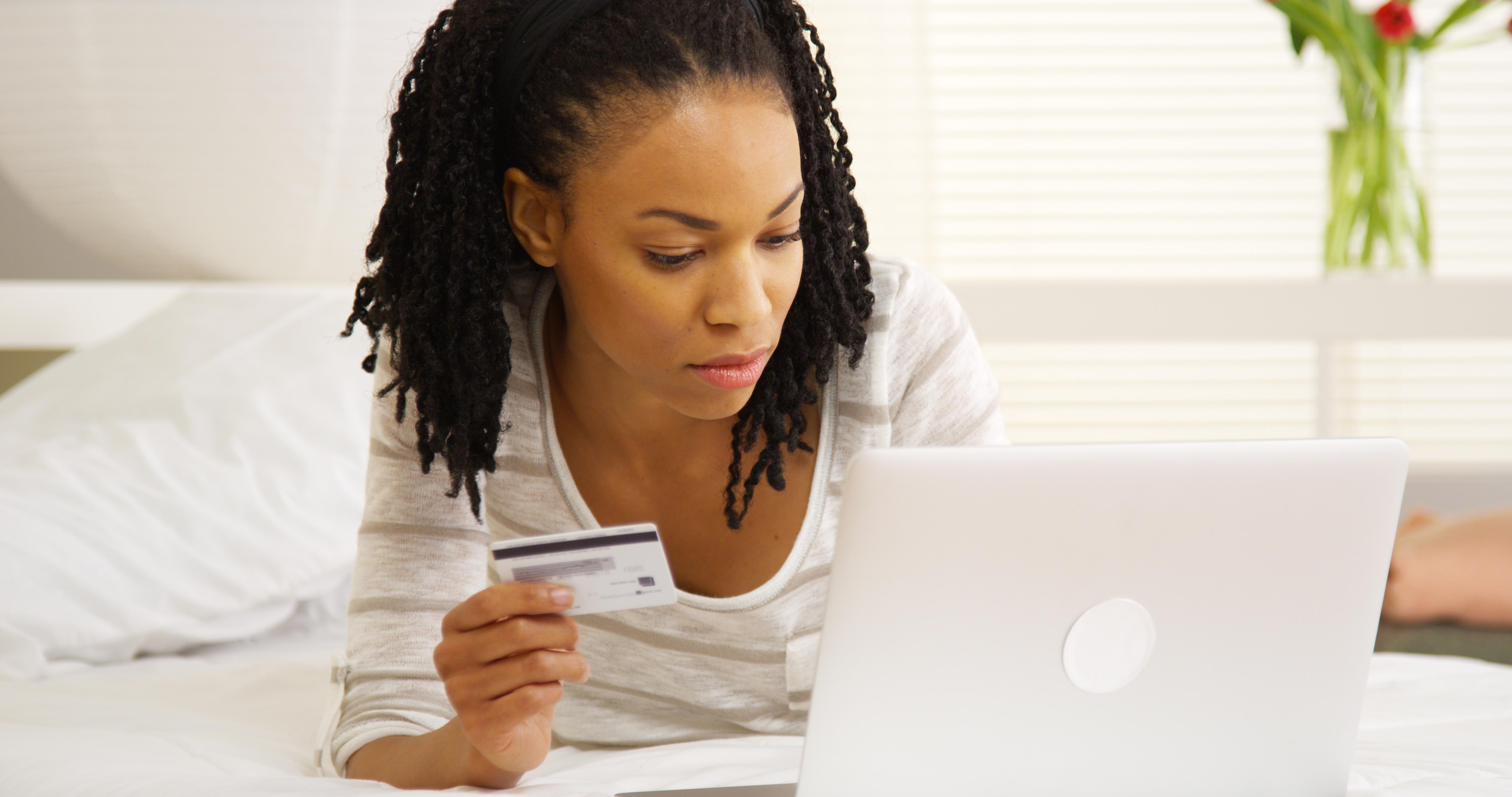 Women shopping online with debit card