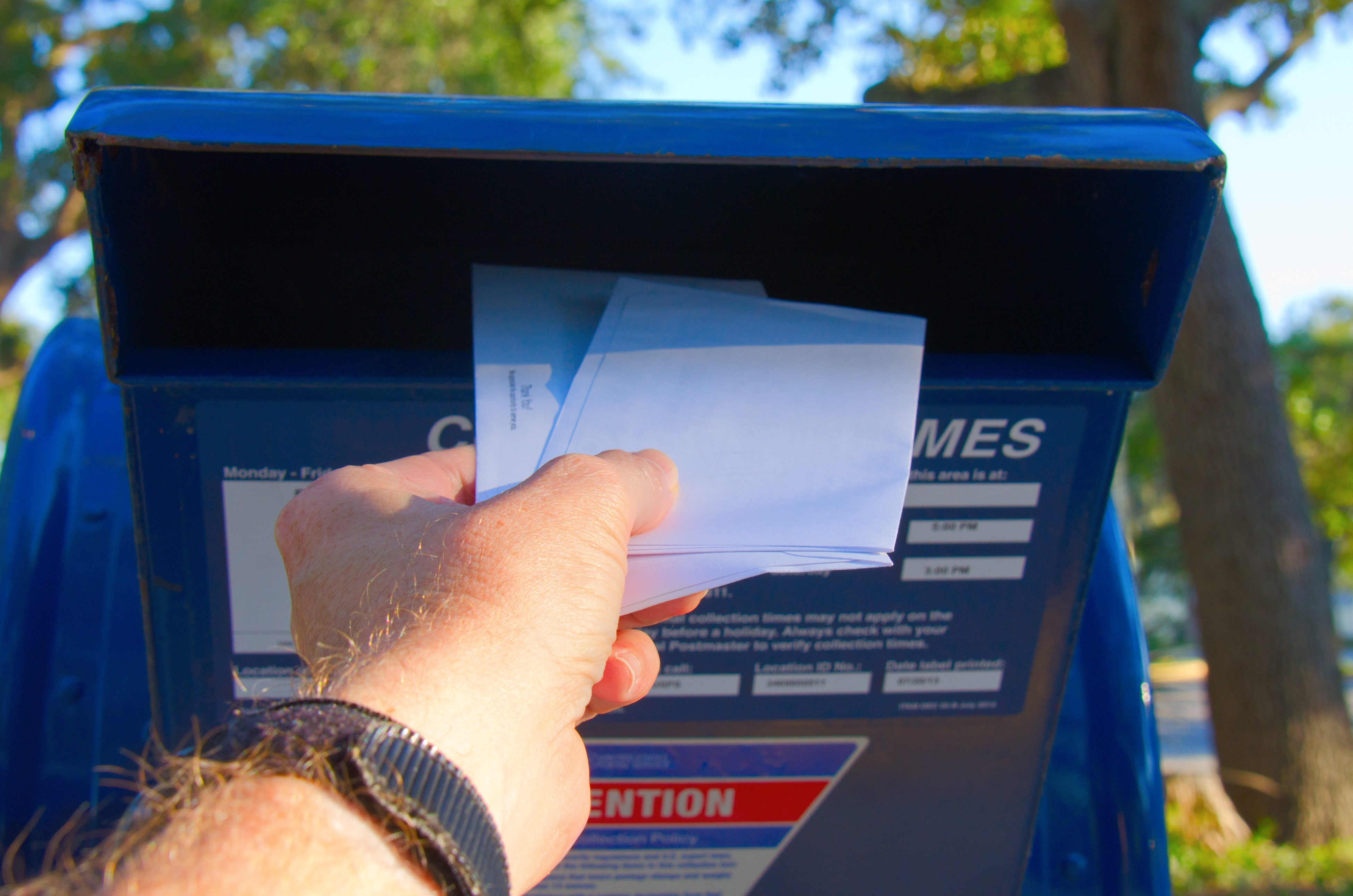 Mail Being Placed in a Post Office Box