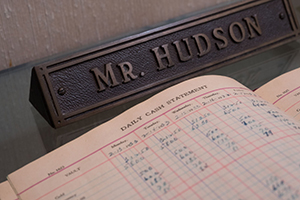 ledger and nameplate for Mr. Hudson