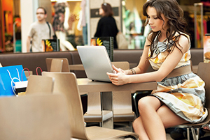 woman working on laptop in a shopping mall