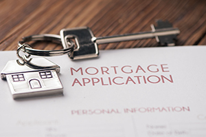 mortgage application with key on top
