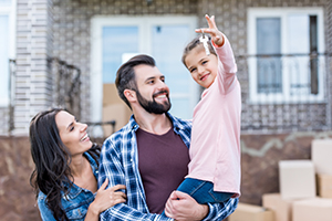 smiling parents with young girl holding keys