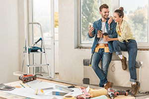 young couple working on home improvement project