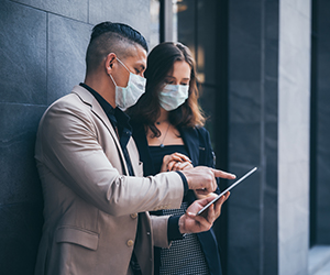 business professionals working together wearing masks: professional services