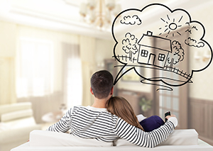 couple on sofa with home thought bubble