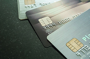 three credit cards spread out on a table