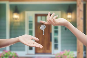 handing over keys to new home