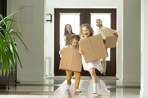 happy family inside with moving boxes