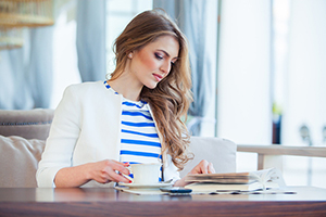 business woman reading a book to enhance business acumen