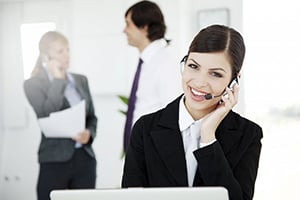 smiling business woman speaking on headset