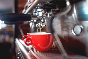 espresso machine with red coffee cups