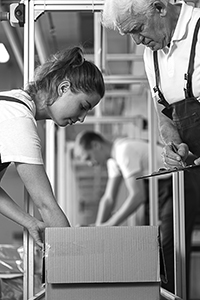 Woman packing a box at a wholesale distribution center