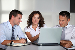 business professionals working on laptop