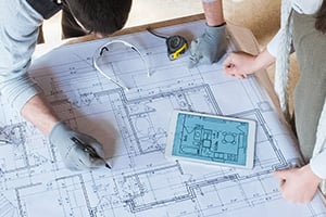couple looking at home plans birds eye view