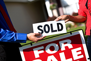 for sale sign marked sold