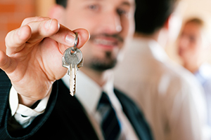 Man holding keys to new home