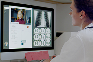 female doctor looking at xrays on computer