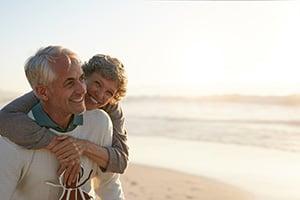 retired elderly couple on the beach