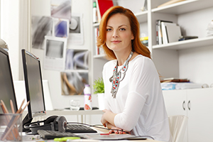 woman posing at home office computer