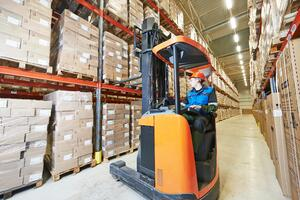 Man operating heavy machinery at a wholesale distribution center