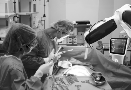 two doctors performing surgery