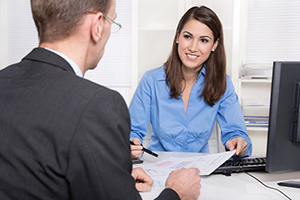 two people discussing commercial banking paperwork