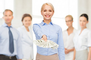 commercial business woman holding out money