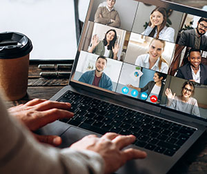 close up of virtual meeting on laptop
