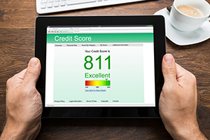 tablet showing excellent credit score of 811