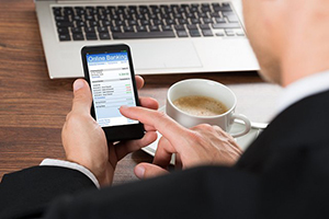 man conducting small business banking on cell phone